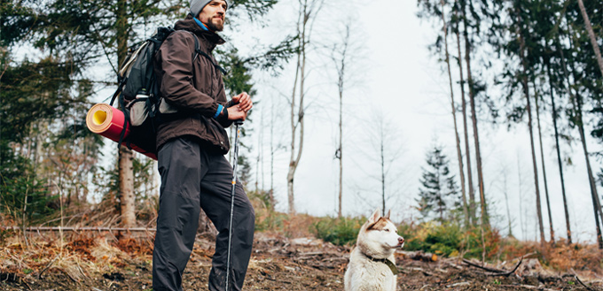 man-hiking-with-his-canine