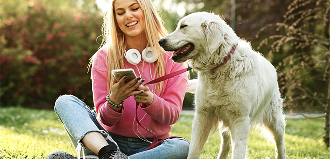 dog with the owner listening to music