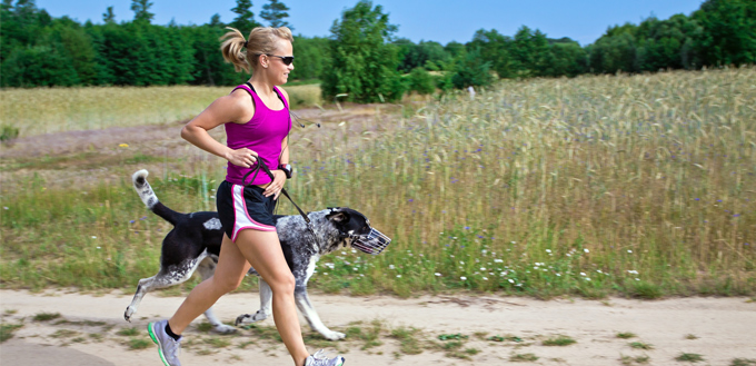 girl running with a dog