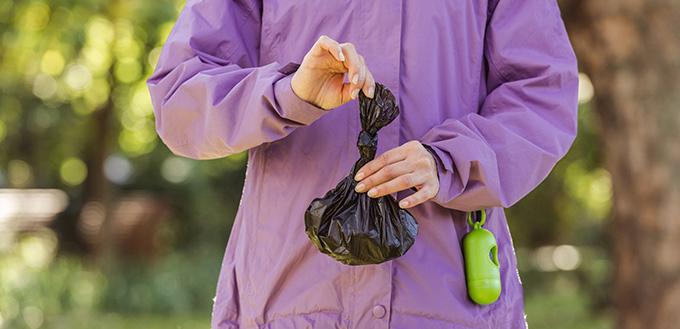 woman holding trash bag