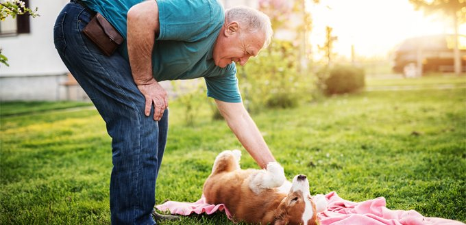 older man with a puppy