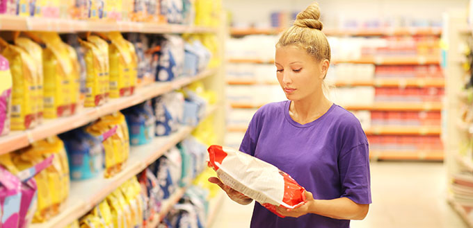 Woman choosing a dairy products at supermarket.